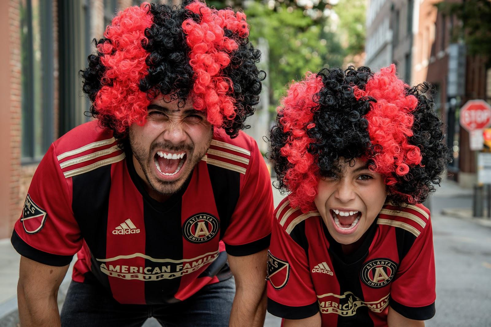 Football fans with wigs